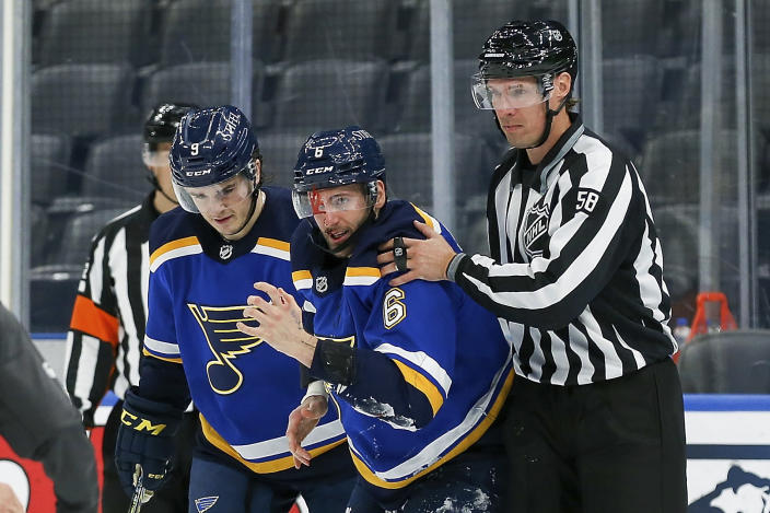 St. Louis Blues' Marco Scandella (6) is assisted by Sammy Blais (9) and linesman Ryan Gibbons (58) after being injured during the third period of the team's NHL hockey game against the Los Angeles Kings on Wednesday, Feb. 24, 2021, in St. Louis. (AP Photo/Scott Kane)