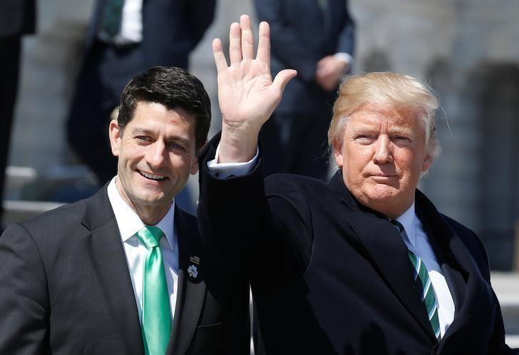 U.S. President Donald Trump waves with Speaker of the House Paul Ryan after attending a Friends of Ireland reception on Capitol Hill in Washington