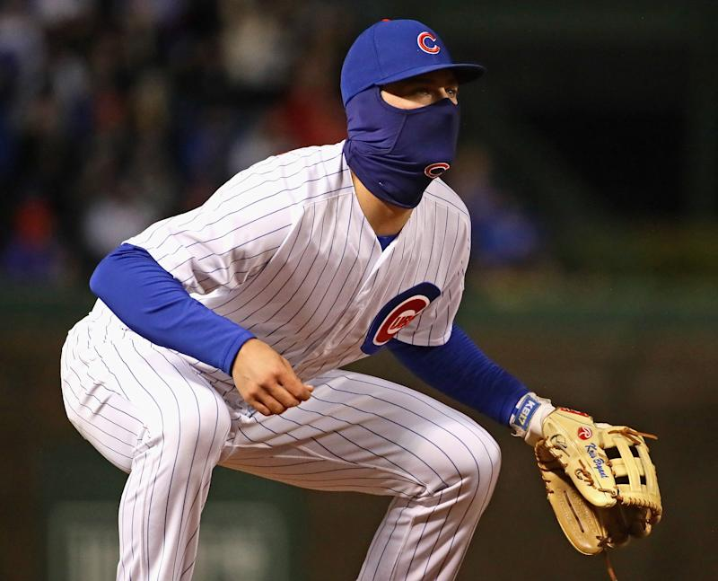 CHICAGO, IL - APRIL 17: Kris Bryant #17 of the Chicago Cubs, bundled up forthe cold, mans third base against the St. Louis Cardinals at Wrigley Field on April 17, 2018 in Chicago, Illinois. (Photo by Jonathan Daniel/Getty Images)