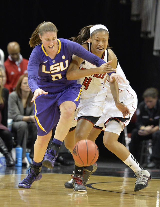 Louisville's Antonita Slaughter, right, battles LSU's Jeanne Kenney for a loose ball during the second half of an NCAA college basketball game on Thursday, Nov. 14, 2013, in Louisville, Ky. Louisville defeated LSU 88-67. (AP Photo/Timothy D. Easley)