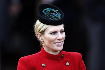 Britain's Zara Phillips smiles in the unsaddling enclosure on Ladies Day at the Cheltenham Festival horse racing meet in Gloucestershire, western England, March 13, 2013. REUTERS/Stefan Wermuth