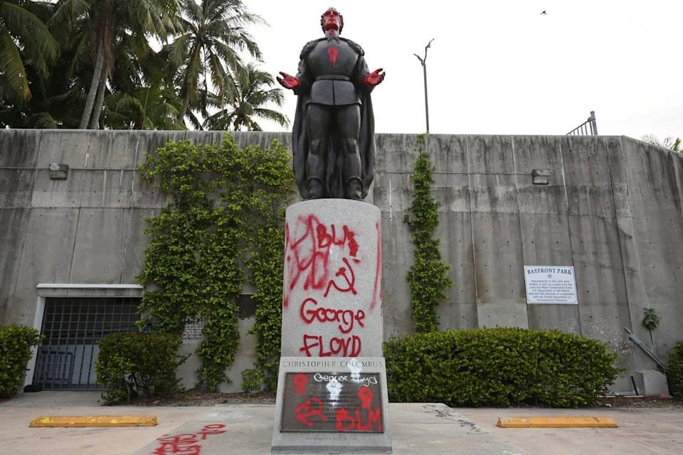 A vandalized statue of Christopher Columbus at Bayfront Park in downtown Miami, Wednesday, June 10, 2020.