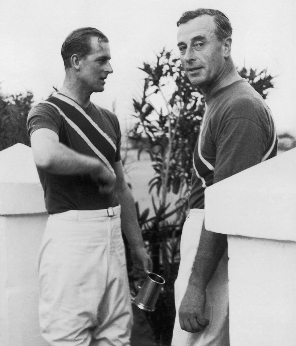<p>Prince Philip, Duke of Edinburgh (left), with his uncle Louis Mountbatten after a polo match. Philip is holding a silver trophy won in the match.</p>