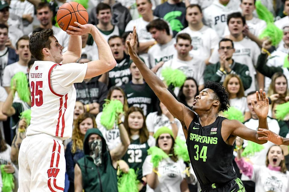 Michigan State's Julius Marble, right, guards Wisconsin's Nate Reuvers during the first half on Friday, Jan. 17, 2020, at the Breslin Center in East Lansing.