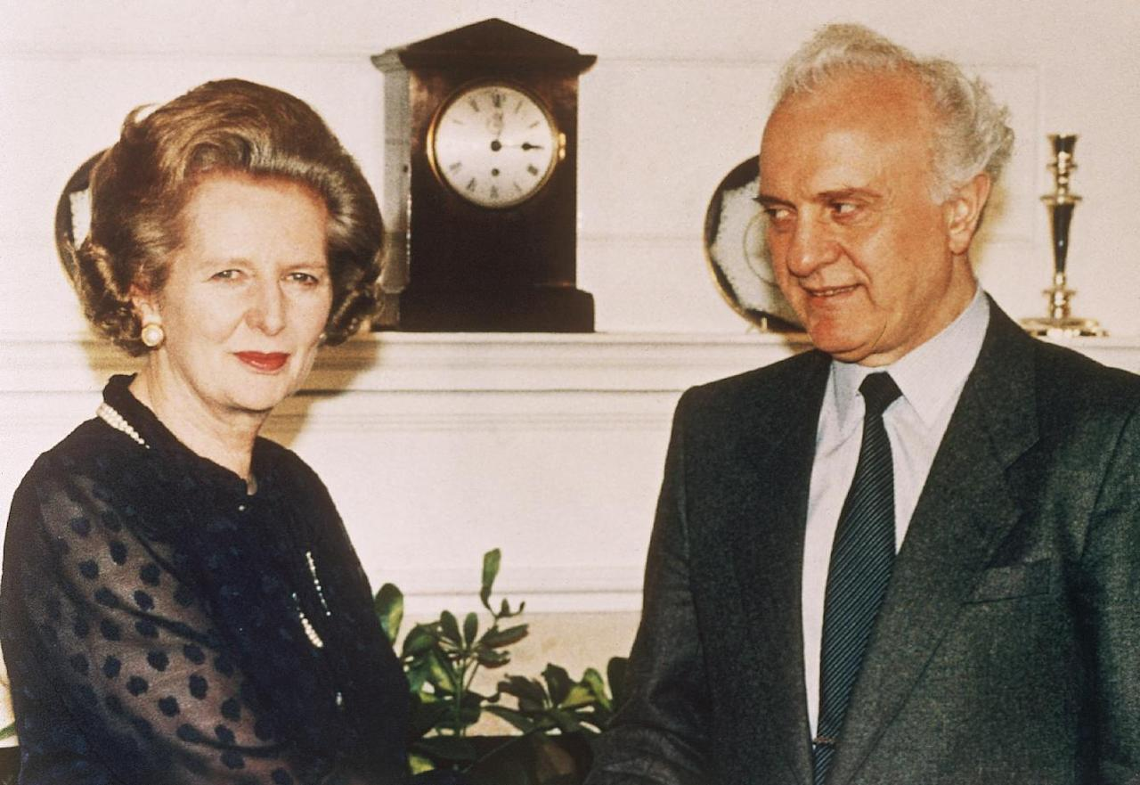 FILE - In this Monday, July 14, 1986 file photo, British Prime Minister Margaret Thatcher welcomes Soviet Foreign Minister Eduard Shevardnadze on his arrival for talks at her 10 Downing Street residence in London. Eduard Shevardnadze, a groundbreaking Soviet foreign minister and later the president of an independent Georgia, died Monday, July 7, 2014, at the age of 86 after a long illness, his spokeswoman said. (AP Photo/ file)