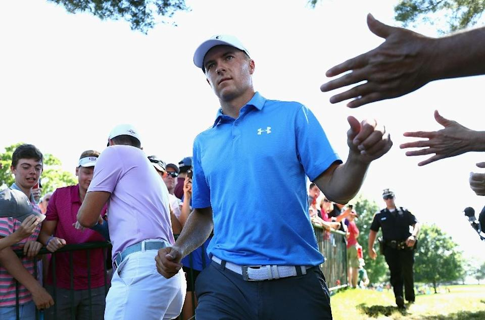 Jordan Spieth of the US high-fives fans after putting on the ninth green during the first round of the Travelers Championship, at TPC River Highlands in Cromwell, Connecticut, on June 22, 2017 (AFP Photo/Maddie Meyer)