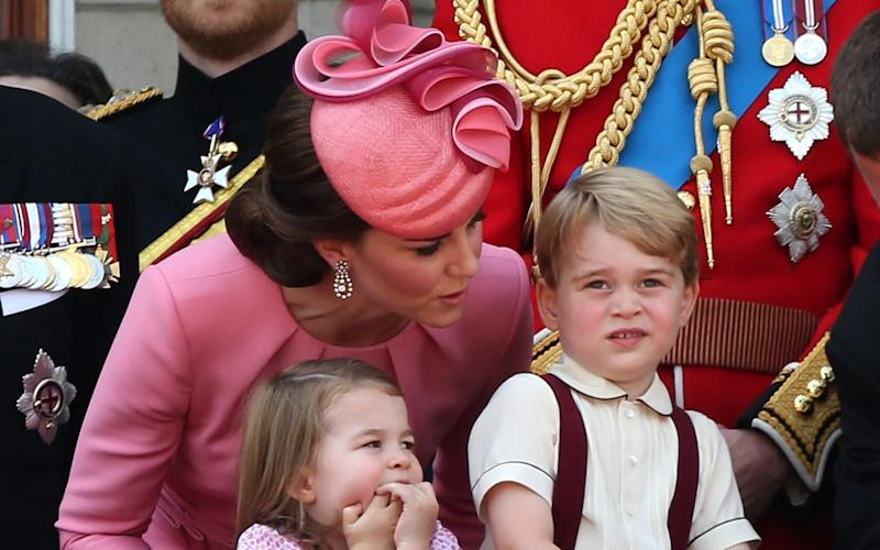 The Duchess of Cambridge, Princess Charlotte and Prince George look out from the balcony of Buckingham Palace during the Trooping the Colour parade - GC Images