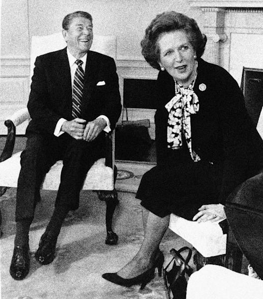 "FILE - In this Feb. 20, 1985 file photo, British Prime Minister Margaret Thatcher turns to look at the crush of photographers in the Oval Office as President Reagan laughs during a photo session at the White House in Washington. It's been most of three decades since debate over ""supply-side"" economic policies was at the center of U.S. politics. But the conservative economic ideas are in the news again, after the death of Thatcher and a scathing attack unleashed last week by Reagan's budget director on years of economic decision-making, including by his former boss. (AP Photo/Scott Applewhite, File)"