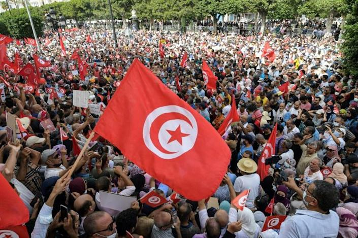 Demonstrators chant slogans during a protest in Tunisia's capital Tunis on September 26, 2021, against President Kais Saied's steps to tighten his grip on power (AFP/FETHI BELAID)
