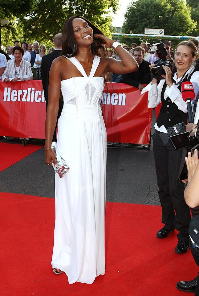"Judging from the hair flip, supermodel Naomi Campbell knows she's a vision in white. Johannes Simon/<a href=""http://www.gettyimages.com/"" target=""new"">GettyImages.com</a> - June 24, 2008"