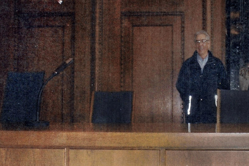 In this May 2000 family photograph provided by Emily DiPalma Aho, Emily DiPalma Aho's father, Emilio DiPalma, stands in the spot where he stood guard as a 19-year-old U.S. Army infantryman at the Nuremberg Nazi war crimes trials. Emilio DiPalma died last month at the age of 93 after contracting the coronavirus at the Holyoke Soldiers' Home in Massachusetts. (Courtesy of Emily DiPalma Aho via AP)