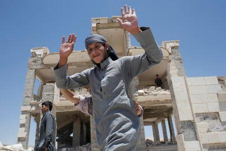 An Islamic State prisoner, who was pardoned by a council that is expected to govern Raqqa once the group is dislodged from the Syrian city, gestures in Ain Issa village, north of Raqqa, Syria June 24, 2017. REUTERS/Goran Tomasevic