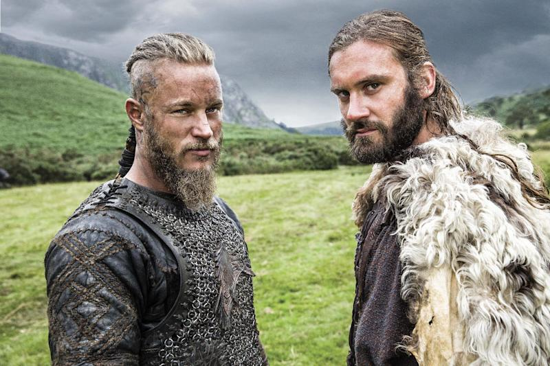 In this photo dated Aug. 28 2013 Brothers Ragnar, left, and Rollo, right, leading characters from television show Vikings, History's brooding and brutal drama about the 8th-century Nordic warrior Ragnar Lothbrok. After a six-month shoot in Ireland, season two debuts Thursday night sporting a bigger scale, more confident pace and stronger entertainment than last year's uneven, at-times plodding inaugural run.(AP Photo/Jonathan Hession/History)