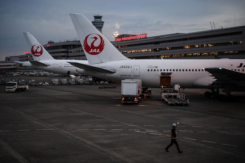 Japan Airlines aircraft are seen on the tarmac at the Tokyo Haneda International Airport on July 11, 2020. (Photo by CHARLY TRIBALLEAU / AFP) (Photo by CHARLY TRIBALLEAU/AFP via Getty Images)