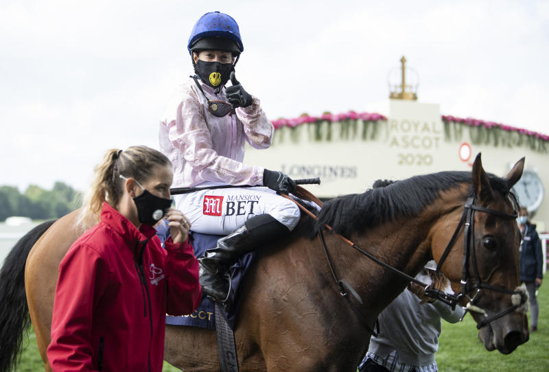 Hayley Turner celebrates on board Onassis after winning the Sandringham Stakes at Royal Ascot, her second career win at the meeting
