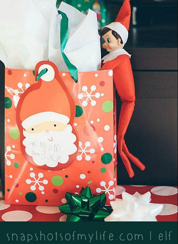 """<p>He gets the run of the house at night, so of course your elf is going to feel tempted to peek at some presents. Hopefully, he won't let the cat out of the bag. </p><p><a href=""""http://snapshotsofasweetlife.blogspot.com/search/label/Elf%20on%20the%20Shelf"""" rel=""""nofollow noopener"""" target=""""_blank"""" data-ylk=""""slk:See more at Snapshots of My Life »"""" class=""""link rapid-noclick-resp""""><em>See more at Snapshots of My Life »</em></a></p>"""