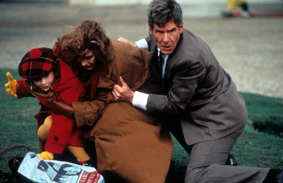 Anne Archer is thrown to the ground by Harrison Ford in a scene from the film 'Patriot Games', 1992. (Photo by Paramount/Getty Images)