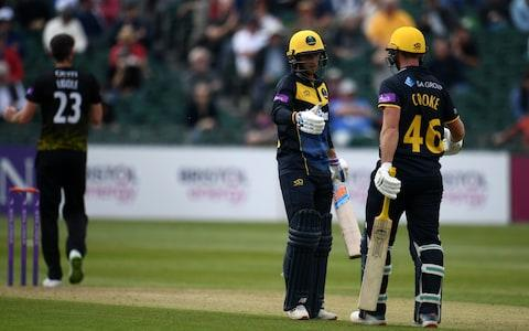 Chris Cooke of Glamorgan(R) embraces Billy Root of Glamorgan after reaching their 200 paetnership during the Royal London One Day Cup match between Gloucestershire and Glamorgan - Credit: GETTY IMAGES