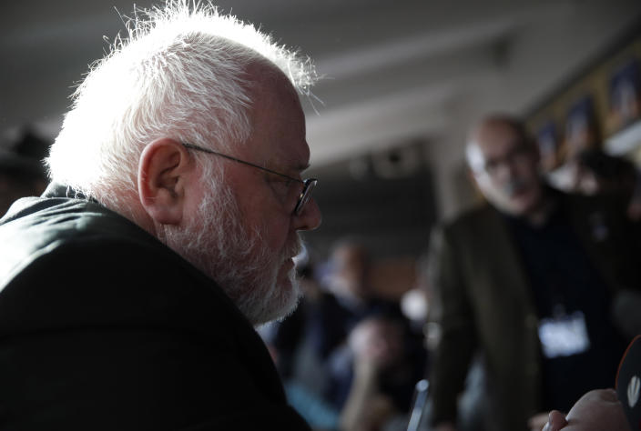 """FILE - In this Feb. 22, 2019 file photo, Cardinal Reinhard Marx, left, listens to sex abuse survivor Jean-Marie Fuerbringer, from Switzerland, as he meets member of the ECA (Ending Clergy Abuse), in Rome, Italy. One of Germany's most prominent Catholic archbishops, in a letter Marx has offered his resignation to Pope Francis. He cited the church's handling of sexual abuse scandals as one reason he wants to step down and said the church had arrived at """"a dead point."""" (AP Photo/Alessandra Tarantino)"""