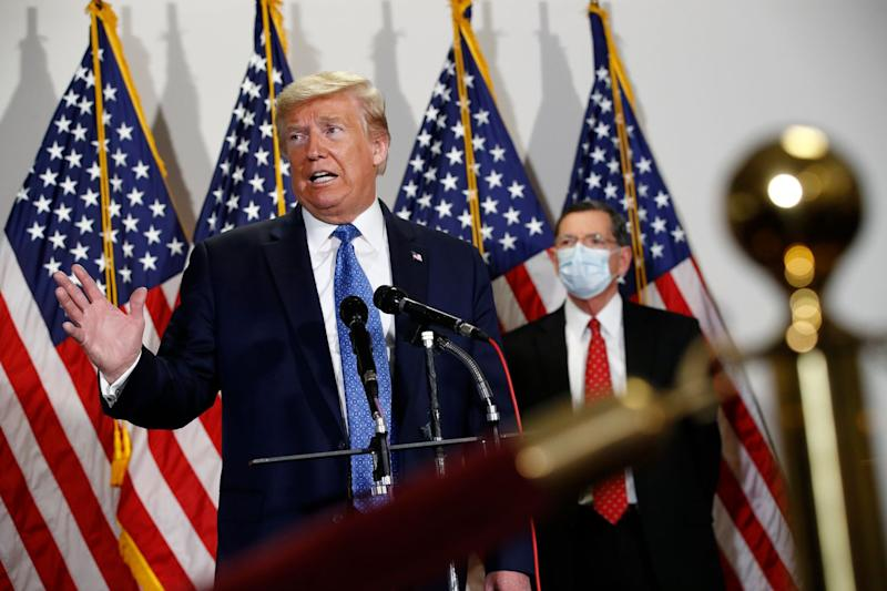 President Donald Trump speaks with reporters after meeting with Senate Republicans at their weekly luncheon on Capitol Hill.