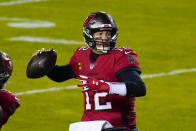 Tampa Bay Buccaneers quarterback Tom Brady (12) looking downfield to pass the ball during the first half of an NFL wild-card playoff football game against the Washington Football Team, Saturday, Jan. 9, 2021, in Landover, Md. (AP Photo/Julio Cortez)