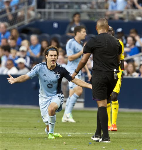 Sporting Kansas City's Graham Zusi pleads for a foul to be called against a Columbus Crew player during an MLS soccer game Saturday, June 29, 2013, in Kansas City, Kan. (AP Photo/The Kansas City Star, Andy Lundberg)
