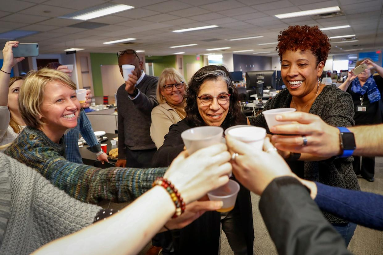 The staff of the Gannett-owned USA TODAY Network's Cincinnati Enquirer celebrate in their newsroom after learning the newspaper won the Pulitzer Prize for local reporting for