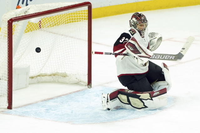 Arizona Coyotes goaltender Antti Raanta (32) lets in a goal by Ottawa Senators left wing Nick Paul during third-period NHL hockey game action in Ottawa, Ontario, Thursday, Feb. 13, 2020. (Chris Wattie/The Canadian Press via AP)