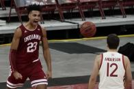 Wisconsin's Trevor Anderson watches as Indiana's Trayce Jackson-Davis reacts after making a shot and being fouled during the second half of an NCAA college basketball game Thursday, Jan. 7, 2021, in Madison, Wis. (AP Photo/Morry Gash)