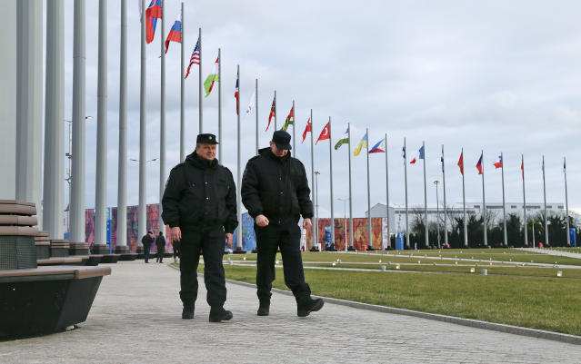Security personnel walk through Olympic Park in preparation for the 2014 Winter Olympics, Wednesday, Feb. 5, 2014, in Sochi, Russia. (AP Photo/Julie Jacobson)