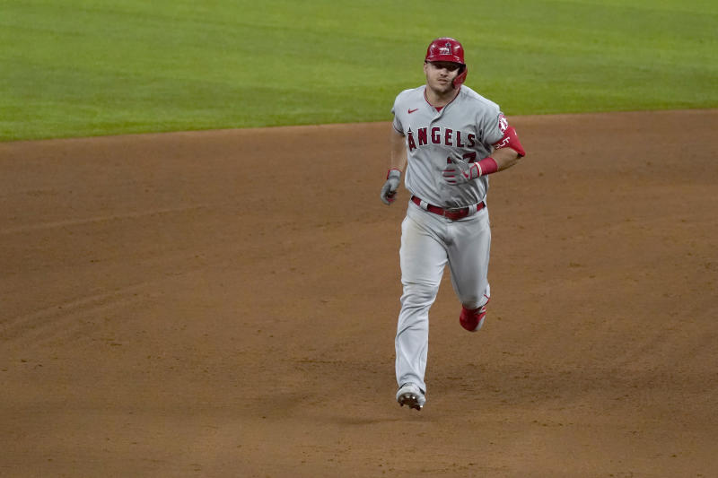 Los Angeles Angels' Mike Trout jogs around the bases after hitting a solo home run in the fifth inning of a baseball game against the Texas Rangers in Arlington, Texas, Thursday, Sept. 10, 2020. (AP Photo/Tony Gutierrez)