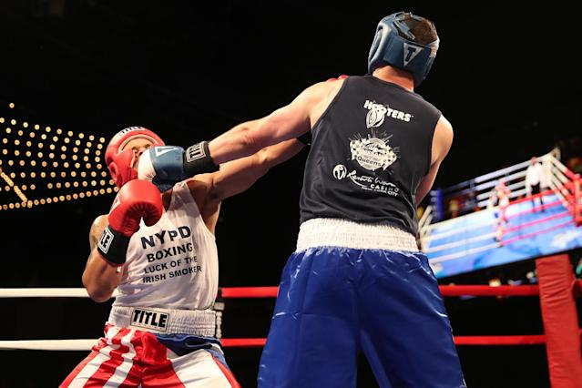 <p>Paul Altimore, left extends his reach into the face of Luis Rodriguez during the NYPD Boxing Championships at the Theater at Madison Square Garden on June 8, 2017.(Photo: Gordon Donovan/Yahoo News) </p>