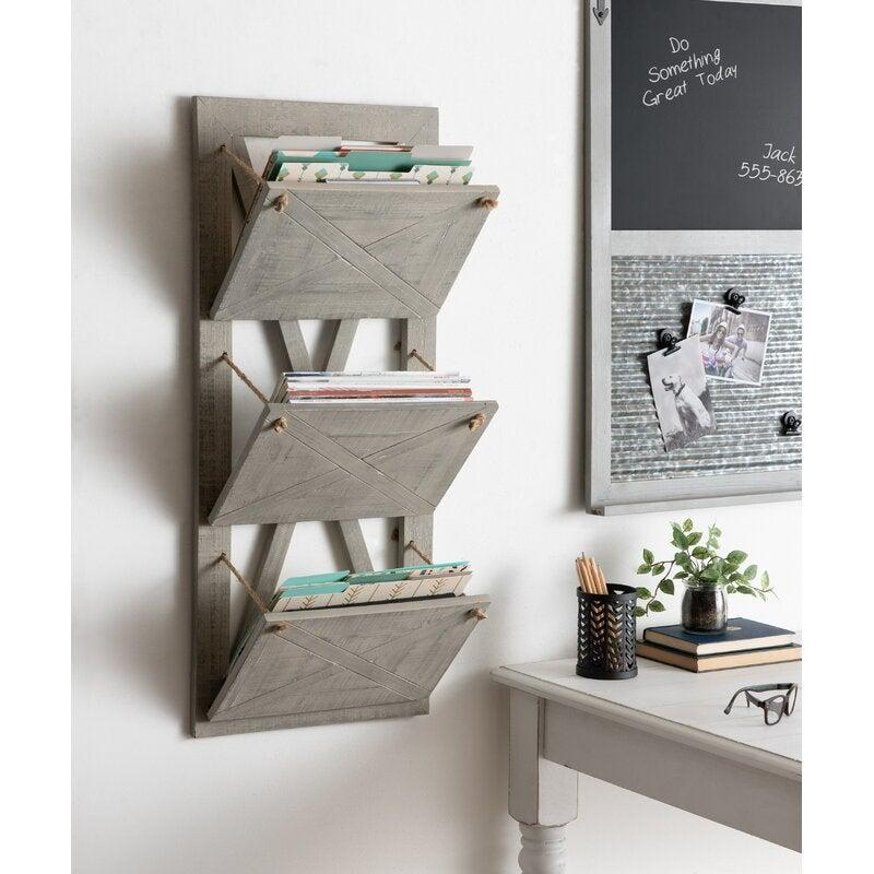 "<h2>Kate and Laurel Hardeman 3 Pocket Hanging Wall File Holder</h2><br>Move over basic black file cabinets, there's a new storage solution in town. This hanging wall holder can add a nice rustic touch to your office and keep your documents in order. <br><br><em>Shop</em> <a href=""https://www.wayfair.com/brand/bnd/kate-and-laurel-b38395.html"" rel=""nofollow noopener"" target=""_blank"" data-ylk=""slk:Kate and Laurel"" class=""link rapid-noclick-resp""><strong><em>Kate and Laurel</em></strong></a><br><br><strong>Kate and Laurel</strong> Hardeman 3 Pocket Hanging Wall File Holder, $, available at <a href=""https://go.skimresources.com/?id=30283X879131&url=https%3A%2F%2Fwww.wayfair.com%2Fcommercial-business-furniture%2Fpdp%2Fkate-and-laurel-hardeman-3-pocket-hanging-wall-file-holder-ktel1471.html"" rel=""nofollow noopener"" target=""_blank"" data-ylk=""slk:Wayfair"" class=""link rapid-noclick-resp"">Wayfair</a>"