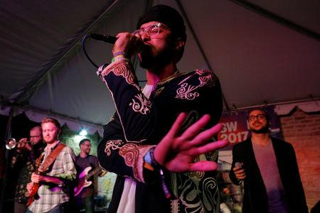 Kayem, who is Libyan-American, performs with Bassel and the Supernaturals, led by Bassel Almadani, who is first-generation Syrian American, at the ContraBand Showcase featuring artists representing countries included in U.S. President Donald Trump's executive order travel bans, at the South by Southwest (SXSW) Music Film Interactive Festival 2017 in Austin, Texas, U.S. March 18, 2017.   REUTERS/Brian Snyder