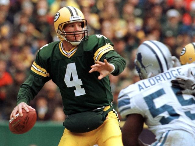 FILE - In this Nov. 21, 1999, file photo, Green Bay Packers quarterback Brett Favre (4) drops back to pass while being rushed by Detroit Lions' Allen Aldridge in the fourth quarter of an NFL football game in Green Bay, Wis. The NFL became a truly booming business in the 1990s, with multi-billion-dollar TV contracts, expansion to 30 teams, and a late-decade wave of new stadiums. Players began to pick up a bigger share of the wealth, with the dawn of unrestricted free agency. The results on the field were largely dominated by the NFC, with Emmitt Smith and the Dallas Cowboys, Steve Young and the San Francisco 49ers, and Favre and the Packers enjoying the most success. Oct. 12, 2014. (AP Photo/Mike Roemer, File)