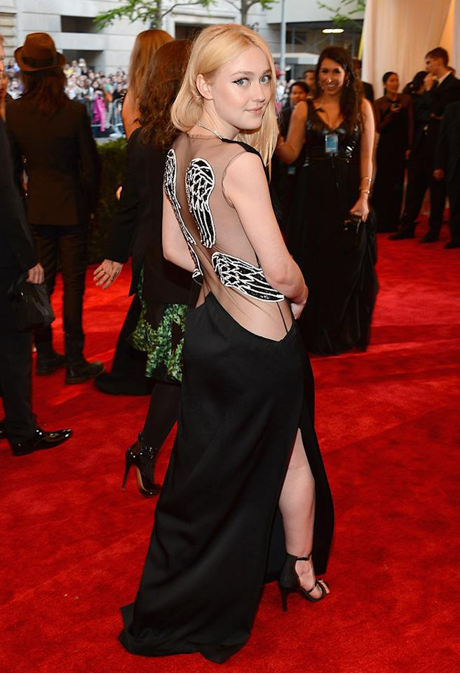 Dakota Fanning proved she's all grown up in a sexy black Rodarte gown, embellished with wing decals and a gold clutch.