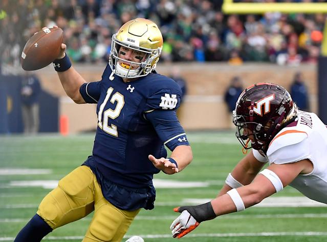 "<a class=""link rapid-noclick-resp"" href=""/ncaaf/players/271127/"" data-ylk=""slk:Ian Book"">Ian Book</a> and Notre Dame barely escaped a huge upset to Virginia Tech. (Getty Images)"