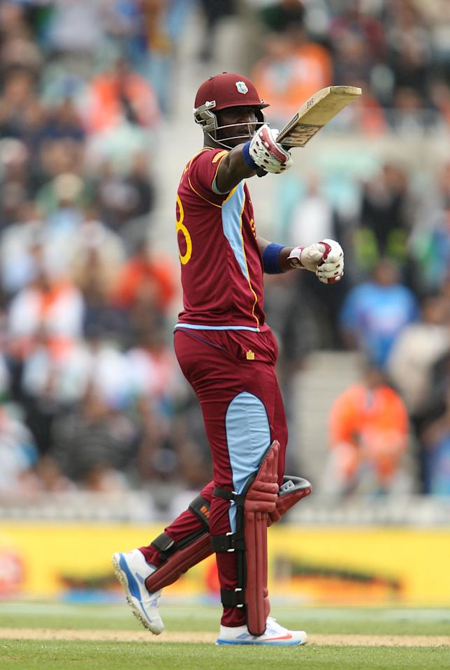 West Indies' Darren Sammy celebrates scoring fifty runs during the ICC Champions Trophy match at the Kia Oval, London.