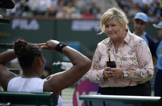 WTA supervisor Donna Kelso, right, speaks with Serena Williams during a match against Garbine Muguruza, of Spain, at the BNP Paribas Open tennis tournament Sunday, March 10, 2019, in Indian Wells, Calif. Williams retired during the match due to a medical issue. (AP Photo/Mark J. Terrill)