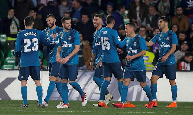 Soccer Football - La Liga Santander - Real Betis vs Real Madrid - Estadio Benito Villamarin, Seville, Spain - February 18, 2018 Real Madrid's Karim Benzema celebrates scoring their fifth goal with teammates REUTERS/Jon Nazca