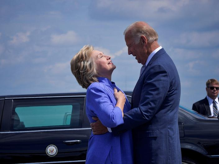 Democratic presidential nominee Hillary Clinton welcomes Vice President Joe Biden as he disembarks from Air Force Two for a joint campaign event in Scranton, Pennsylvania, on 15 August 2016 ((Reuters))