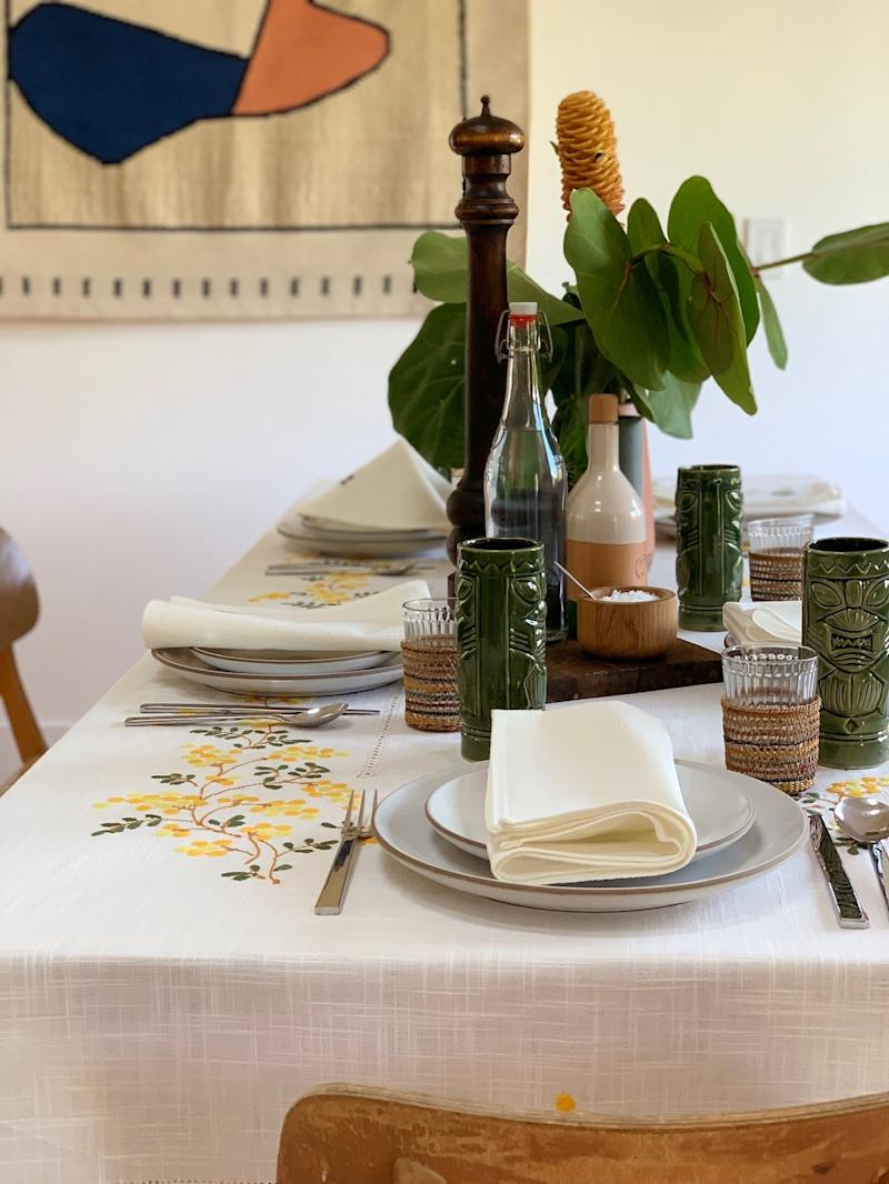 What's on his table: Heath Ceramics Coupe Line, Alessi Santiago Flatware by David Chipperfield Vintage glassware, tiki highball, cutting board, pepper mill, handmade table linens from a small linen shop in Rome