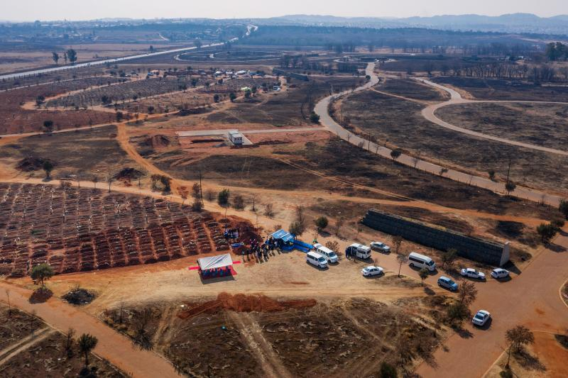 This aerial picture shows funerals taking place at the Olifantsvlei Cemetery in Soweto. Source: AFP