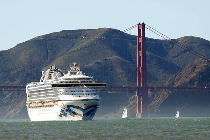 In this Feb. 11, 2020, photo, the Grand Princess cruise ship passes the Golden Gate Bridge as it arrives from Hawaii in San Francisco. California's first coronavirus fatality is an elderly patient who apparently contracted the illness on a cruise, authorities said Wednesday, March 4, and a medical screener at Los Angeles International Airport is one of six new confirmed cases. The cruise ship is at sea but is expected to skip its next port and return to San Francisco by Thursday, according to a statement from Dr. Grant Tarling, the chief medical officer for Carnival Corp., which operates the Grand Princess. Any current passengers who were also on the February trip will be screened.