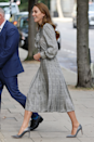 <p>Kate Middleton just stepped out at University College of London wearing a familiar-looking Zara dress, with a houndstooth print, featuring a pleated skirt and pussy-bow blouse. The Duchess finished the outfit with a pair of grey pumps and her signature bouncy blowout. Recognise the dress, though? Scroll through to see the last time Kate repped the piece.</p>