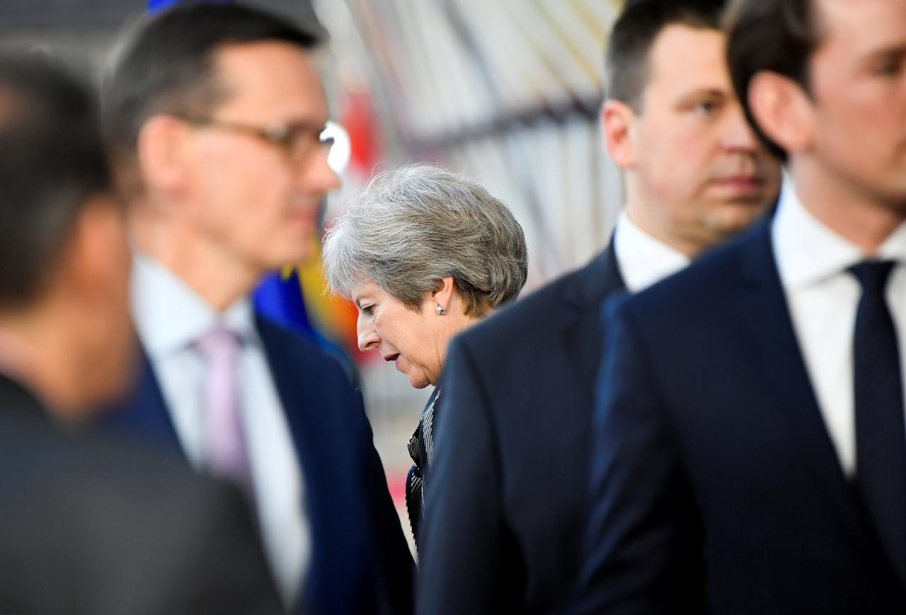 Britain's Prime Minister Theresa May leaves after the ASEM leaders group photo opportunity during a summit in Brussels, Belgium October 19, 2018. REUTERS/Toby Melville     TPX IMAGES OF THE DAY