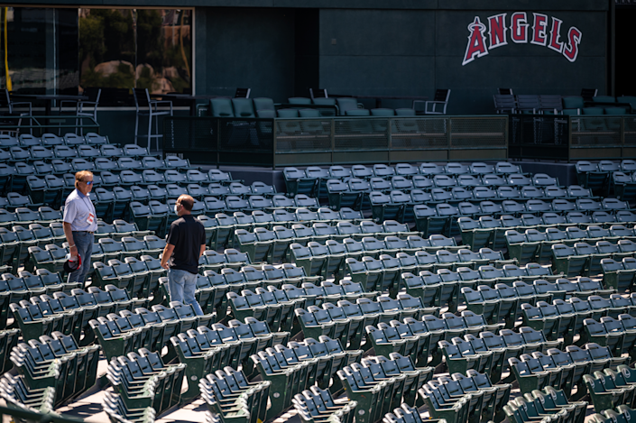 Angels general manager Billy Eppler, right, speaks with Hall of Fame manager Tony La Russa at Angel Stadium.