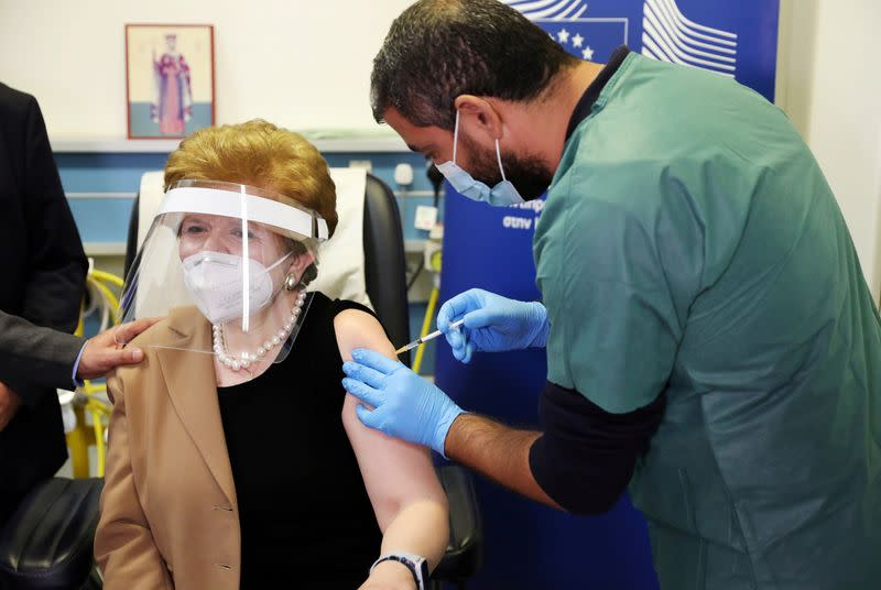 Christina Yiannaki, general manager of the Ministry of Health, receives an injection with a dose of Pfizer-BioNTech COVID-19 vaccine at the Famagusta General Hospital, as the coronavirus disease (COVID-19) outbreak continues, in Dherinia