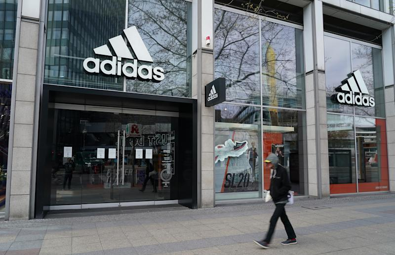 BERLIN, GERMANY - APRIL 15: A man walks past a temporarily closed Adidas store during the coronavirus crisis on April 15, 2020 in Berlin, Germany. As the rate of new infections nationwide continues to slow, the German government is seeking to establish and implement a roadmap for easing restrictions on public life and the burden the virus is having on the economy. So far over there are over 130,000 cases of confirmed infection of coronavirus in Germany, over 3,000 people have died and over 57,000 people have recovered. (Photo by Sean Gallup/Getty Images)
