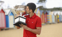 Serbia's Novak Djokovic kisses the Norman Brookes Challenge Cup at Brighton Beach after defeating Russia's Daniil Medvedev on Sunday Feb. 21, 2021 in the men's singles final at the Australian Open tennis championship in Melbourne, Australia, Monday, Feb. 22, 2021.(AP Photo/Hamish Blair)
